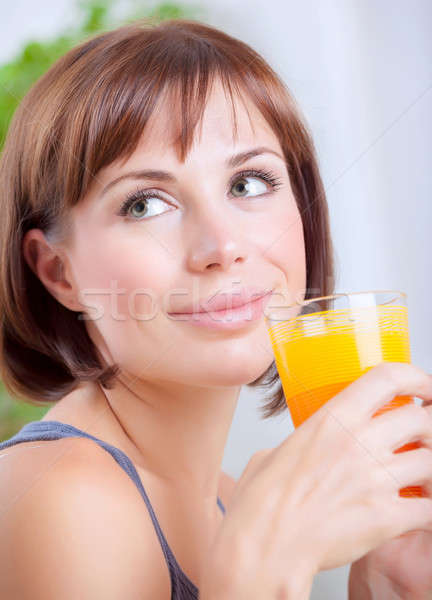 Cute female drinking juice Stock photo © Anna_Om