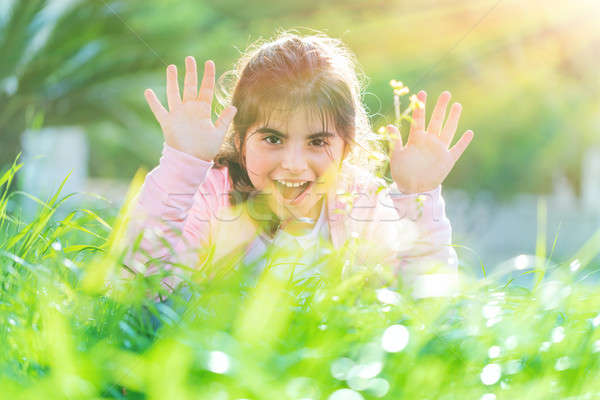 Pretty child playing outdoors Stock photo © Anna_Om