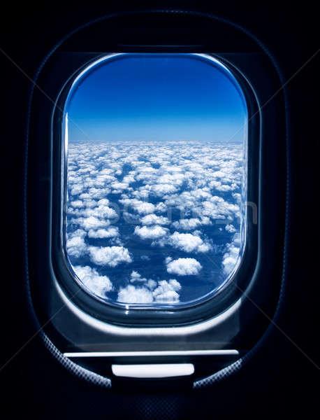 Belle blanche pelucheux nuages avion Photo stock © Anna_Om