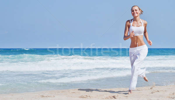 Stock photo: Healthy woman running on the beach