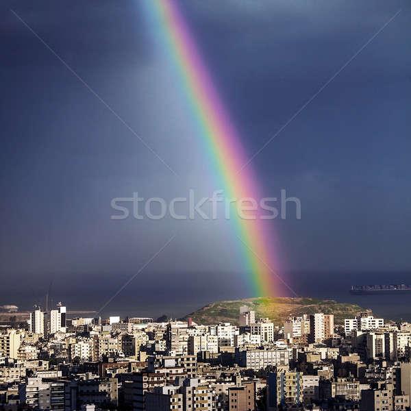 Bright rainbow over city Stock photo © Anna_Om