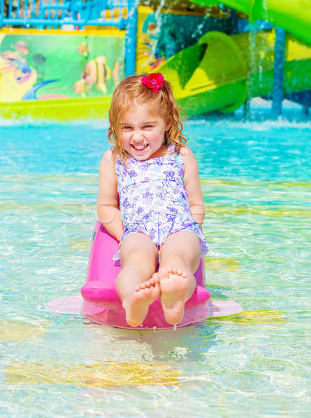 Happy girl on water attractions Stock photo © Anna_Om