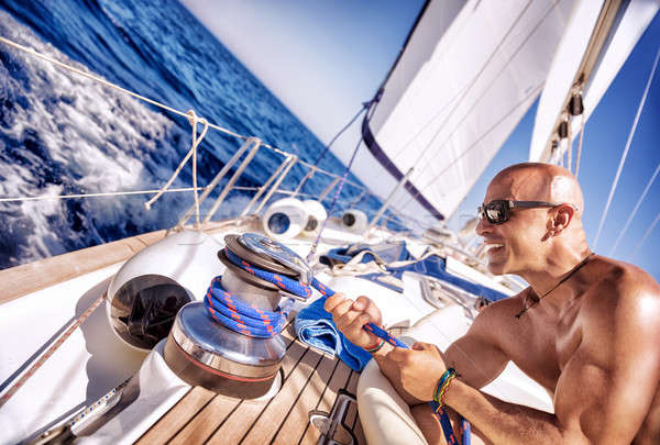 Handsome strong man working on sailboat Stock photo © Anna_Om