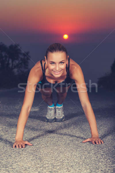Sportive woman doing pushups outdoors Stock photo © Anna_Om