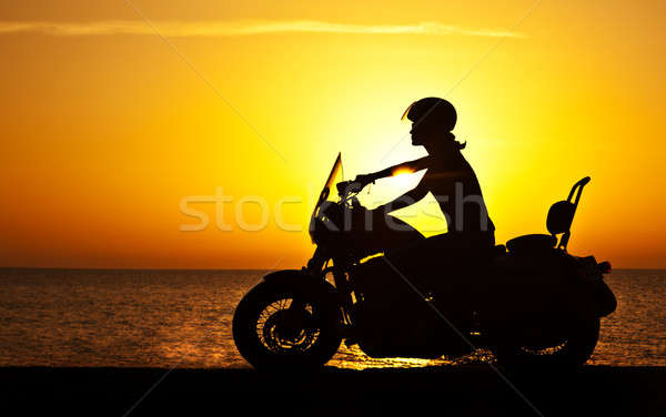 Woman biker over sunset  Stock photo © Anna_Om