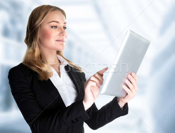 Business lady with touch pad Stock photo © Anna_Om