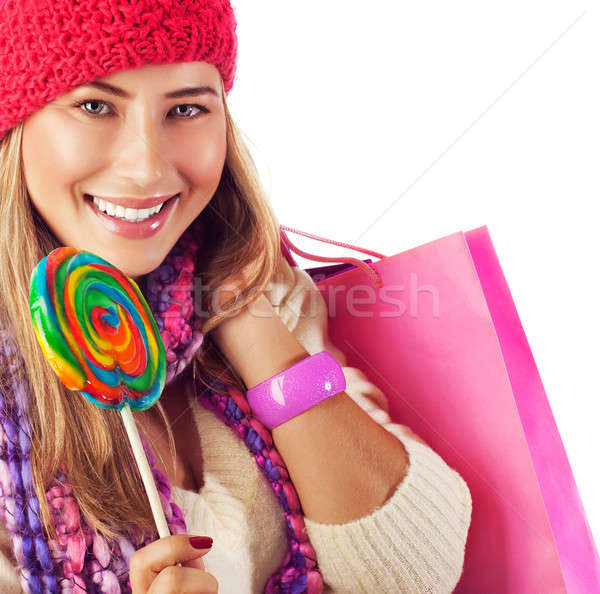 Girl lick sweets and holding pink bag Stock photo © Anna_Om