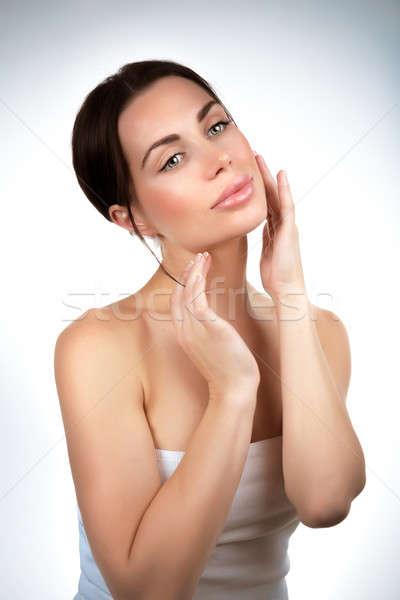 Belle femme portrait studio toucher visage crème Photo stock © Anna_Om