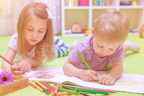 Happy baby boy & girl enjoying homework Stock photo © Anna_Om