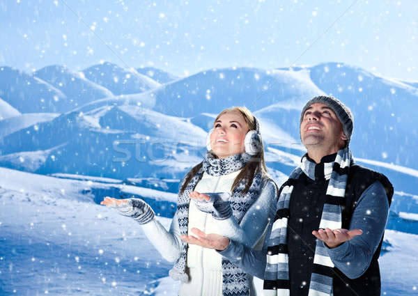 Happy couple playing outdoor at winter mountains Stock photo © Anna_Om