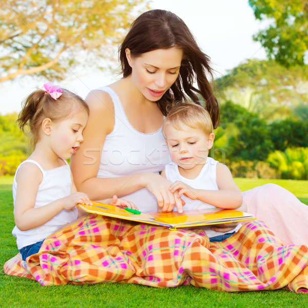 Little kids with mommy read book Stock photo © Anna_Om