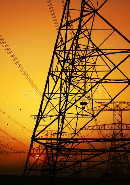Eletricidade laranja pôr do sol céu ambiental dano Foto stock © Anna_Om