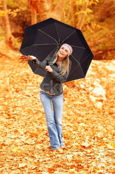 Beautiful female under umbrella Stock photo © Anna_Om