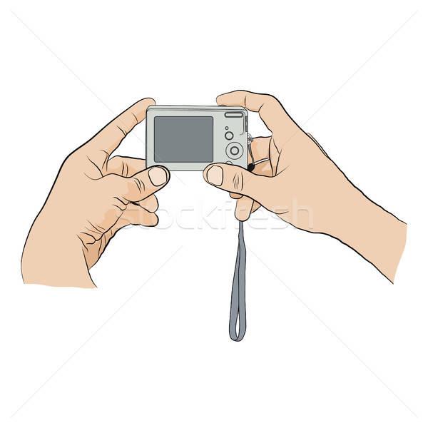 Two hands  with  digital camera.  Stock photo © anna_solyannikov