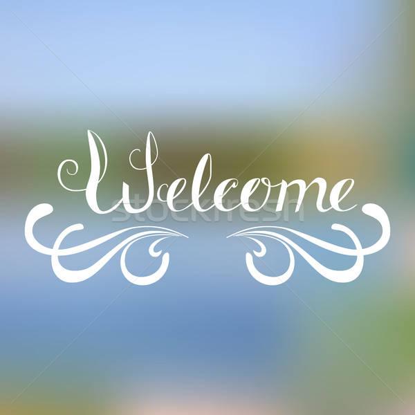 Welcome - hand lettering  on blurred background.  Stock photo © anna_solyannikov