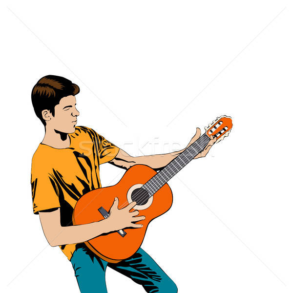 Young man playing the guitar .  Stock photo © anna_solyannikov