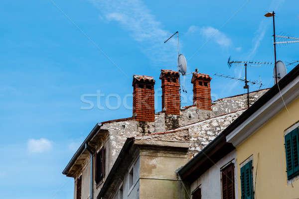 Stock photo: Three Red Chimneys on Roof in Porec, Croatia