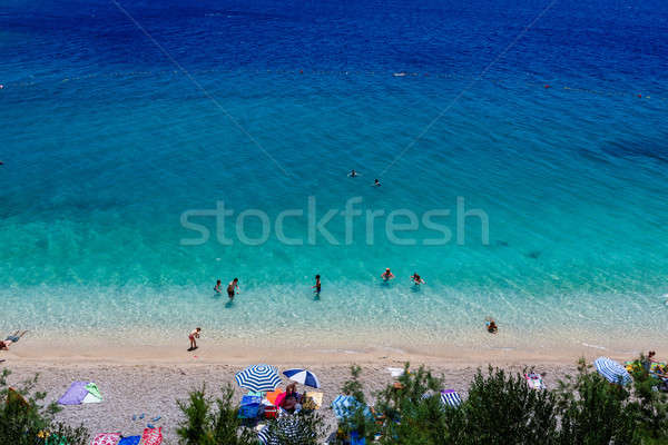 Mooie strand transparant Blauw water hemel Stockfoto © anshar