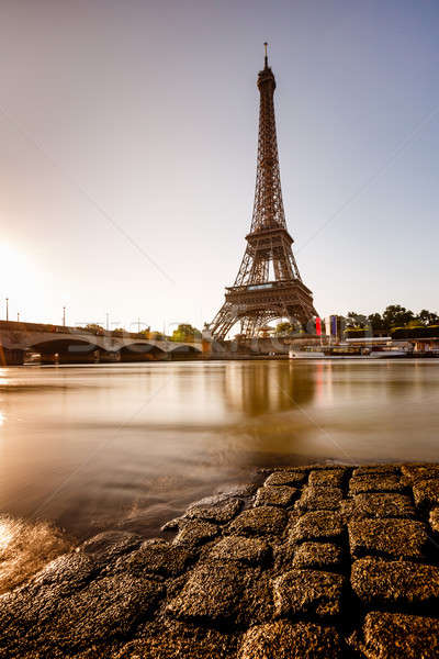Eiffel Tower and Cobbled Embankment of Seine River at Sunrise, P Stock photo © anshar