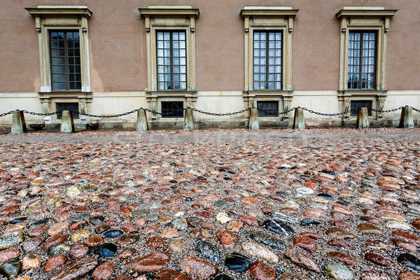 Wet Cobblestone and King Palace Facade in Gamla Stan (Old Town)  Stock photo © anshar