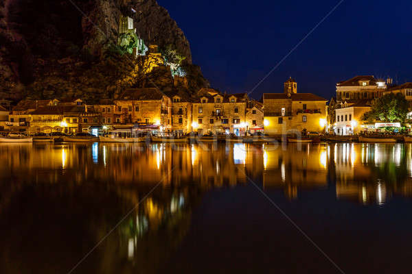 Stock photo: Illuminated Pirate Castle and Town of Omis Reflecting in the Cet