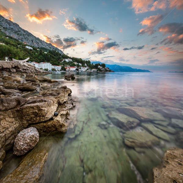 Sunrise on Rocky Beach and Small Village near Omis, Dalmatia, Cr Stock photo © anshar