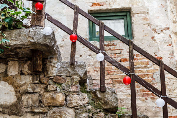 Wooden Railing with Red and White Lamps in Rovinj, Croatia Stock photo © anshar