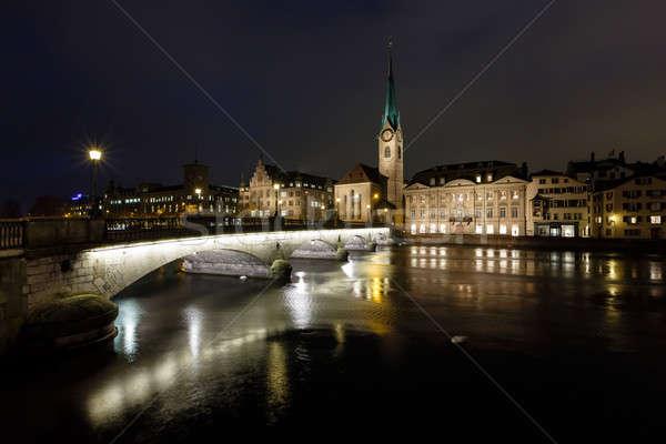 Illuminated Fraumunster Church and River Limmat in Zurich, Switz Stock photo © anshar