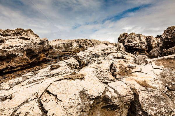 Cracked Cliffs on Rocky Beach in Cascais near Lisbon, Portugal Stock photo © anshar