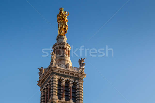 Golden Statue of the Madonna Holding the little Jesus on the top Stock photo © anshar