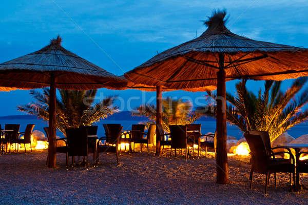 Umbrellas on Pebble Beach at Night, Brela, Croatia Stock photo © anshar