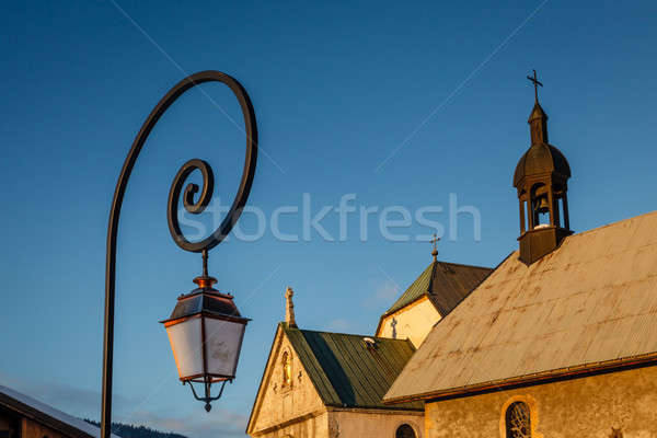 Street Lamp and Medieval Church in Megeve, French Alps Stock photo © anshar