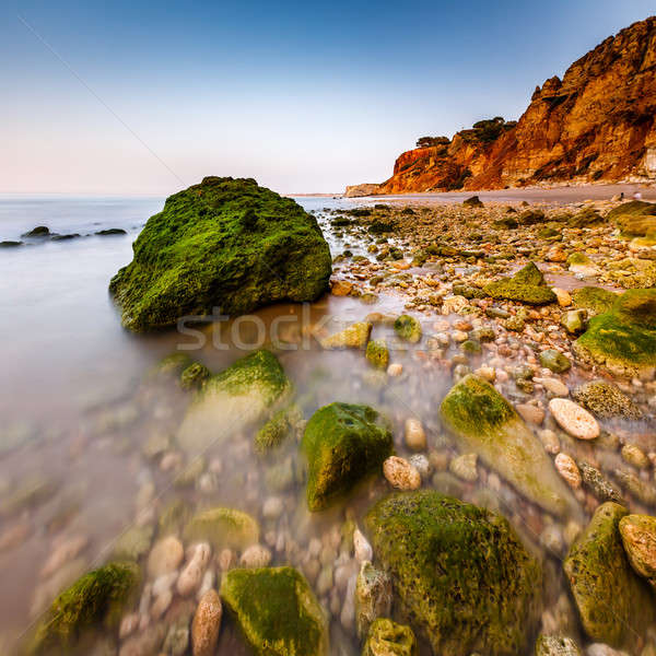 Rocks and Cliffs of Porto de Mos Beach in the Morning, Lagos, Al Stock photo © anshar