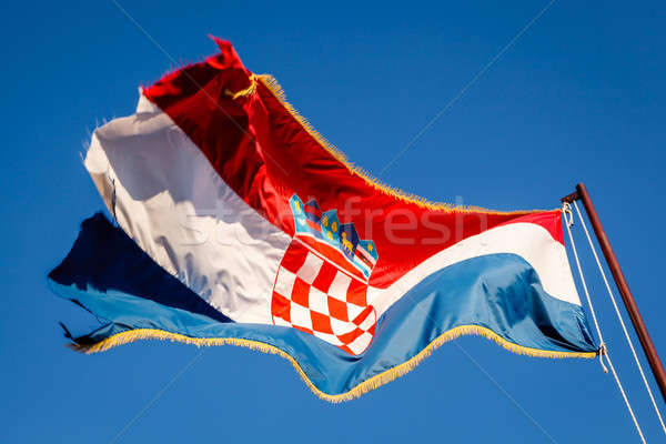 Croatian Flag Waving on a Pole over Beautiful Blue Sky in Omis,  Stock photo © anshar