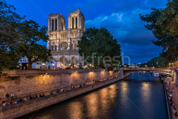 The Cathedral of Notre Dame de Paris and Seine River in the Even Stock photo © anshar