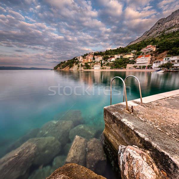 Stockfoto: Steen · klein · dorp · dawn · strand · water