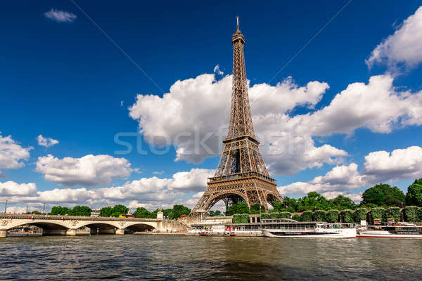 Эйфелева башня реке Париж Франция дерево облака Сток-фото © anshar