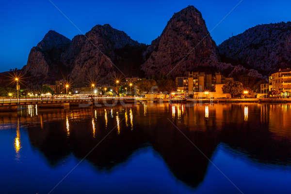 Mountain Silhouettes and Illuminated Town of Omis, Croatia Stock photo © anshar