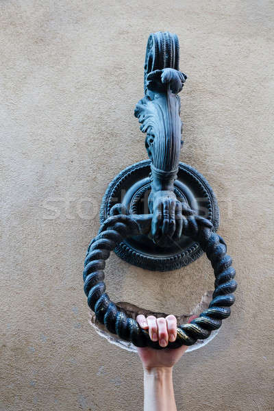 Hand Holding the Metal Ring to Tie Horses in Siena, Tuscany, Ita Stock photo © anshar