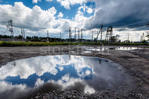 Stock photo: Cloudy Sky Reflected in Huge Road Puddle near Moscow, Russia