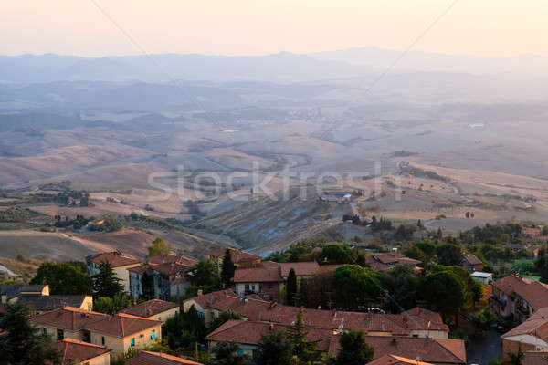 Roofs and Landscape of a Small Town Volterra at Sunset in Tuscan Stock photo © anshar