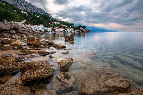 Plaj küçük köy sabah gökyüzü bulutlar Stok fotoğraf © anshar