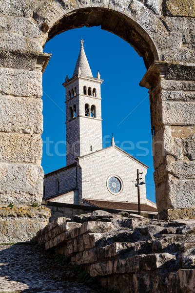 White Church Framed in the Arch of Ancient Roman Amphitheater in Stock photo © anshar