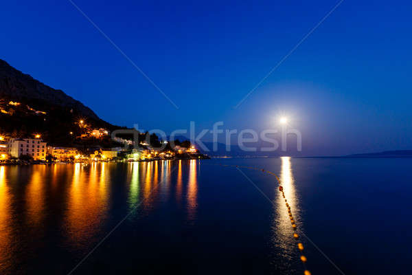 Small Dalmatian Village and Adriatic Sea Bay Illuminated by Moon Stock photo © anshar
