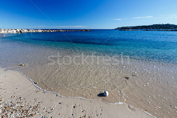 Sunny Beach and Breakwater in Antibes on French Riviera, France Stock photo © anshar