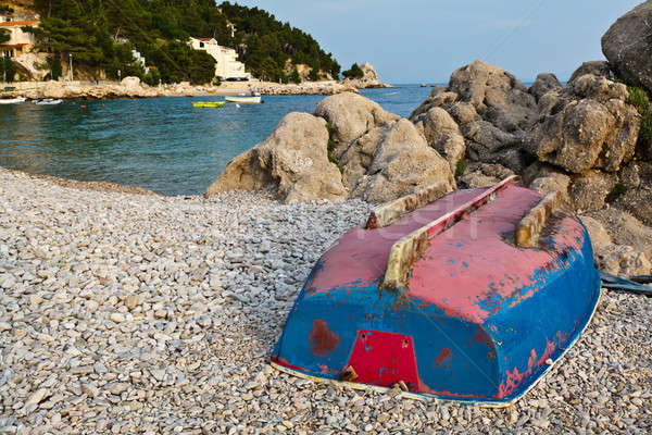 Upside Down Boat on the Rocky Beach in Croatia Stock photo © anshar