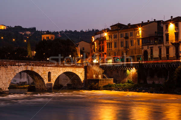 Ancient Roman Bridge over Adige River in Verona at Morning, Vene Stock photo © anshar