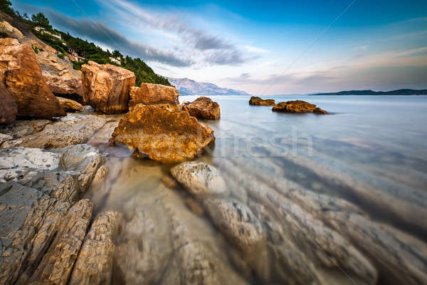 Rocky Beach and Transparent Adriatic Sea near Omis in the Evenin Stock photo © anshar