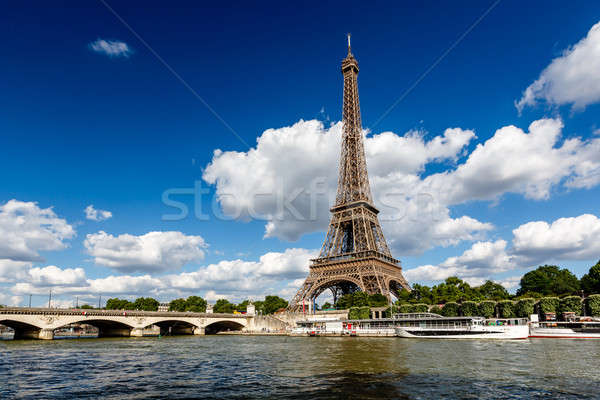 Eiffel Tower and Seine River with White Clouds in Background, Pa Stock photo © anshar