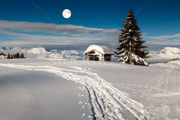Luna piena sopra piccolo capanna top Foto d'archivio © anshar
